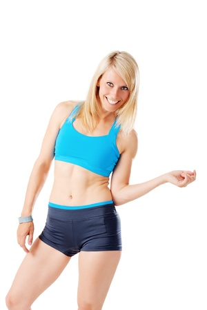 Blonde woman in sports wear smiling isolated on white Stock Photo - 20953180