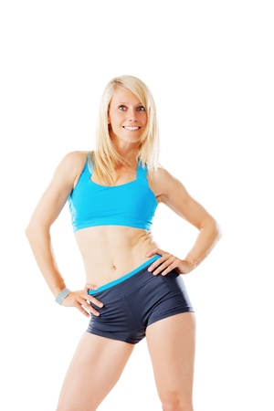 Sporty blonde woman smiling straight to the camera isolated on white Stock Photo - 21091145