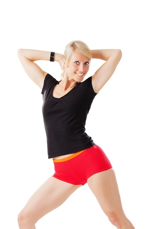 Blonde woman warming up her body by stretching isolated on white Stock Photo - 21091147