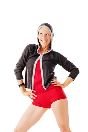Blonde female satisfied smiles after sport isolated on white photo