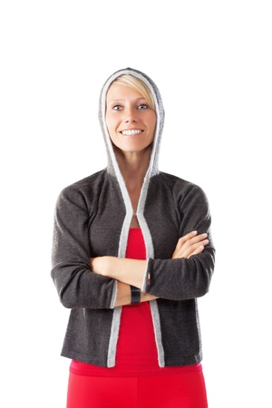 Blonde female in sports wear looking straight to the camera smiling isolated on white Stock Photo - 21091150