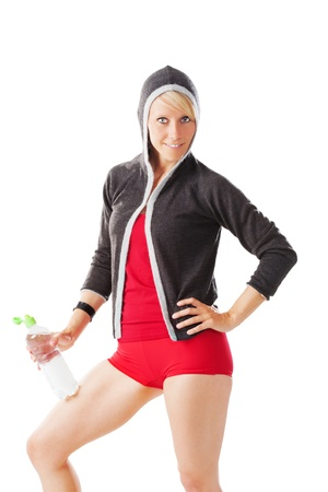 Perfect shaped female in fitness dress holding a water bottle isolated on white Stock Photo - 21091153