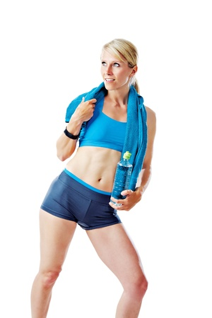 sports wear: Blonde woman in sports wear holding a water bottle and a towel isolated on white Stock Photo