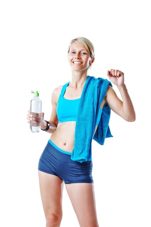 Female in sports wear happy after workout refreshing herself with water and smiling to the camera isolated on white photo