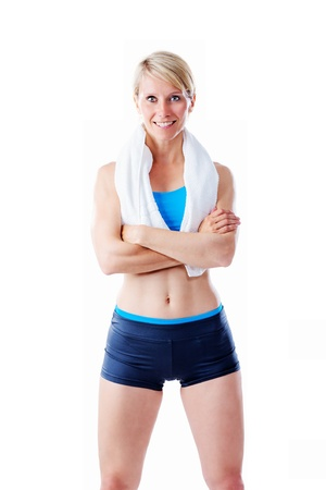 Female fitness trainer smiling to the camera with arms crossed isolated on white photo