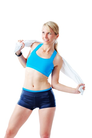 Sporty woman holding a towel around her back isolated on white photo