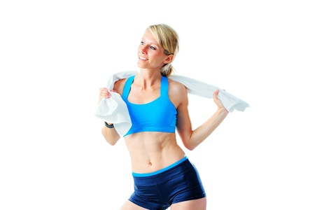 Sporty woman playing with white towel after workout isolated on white photo