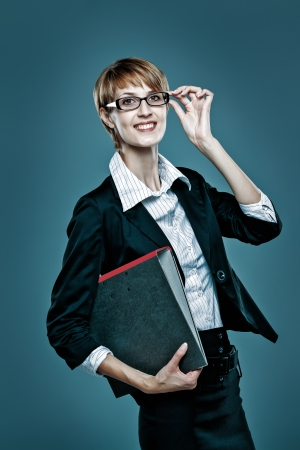 Portrait of a smart business woman holding a folder isolated