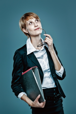 Young business woman with folder thinking  blue background