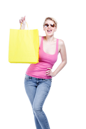 Young woman holding a yellow shopping bag