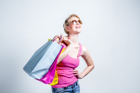 Relaxed young woman with shopping bags Stock Photo