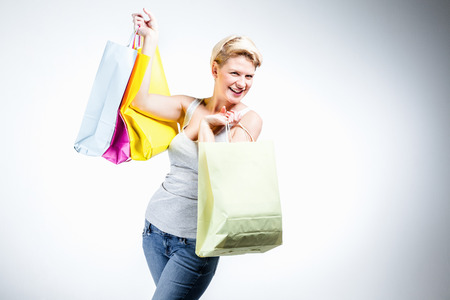 Young woman happy holding colored bags Stock Photo