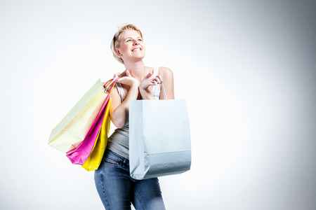 Woman looking up holding bags photo