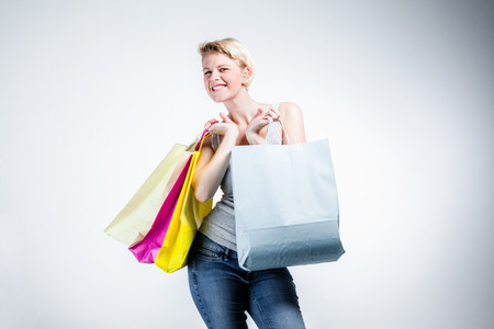 Woman with colored shopping bags Stock Photo