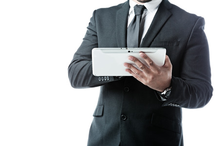 Close up of businessman working with a touchpad isolated on white photo