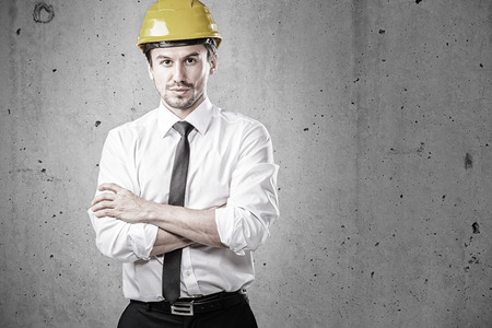 Portrait of an architect with arms crossed at site Stock Photo