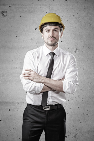 Young architect standing in front of a concrete wall Stock Photo