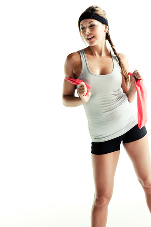 resistance: Sporty woman with resistance band isolated on white