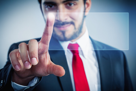 touchpad: Businessman pointing finger to push a virtual touchpad