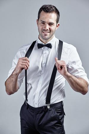suspenders: Suspenders isolated over grey Stock Photo
