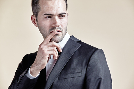 Businessman pointing his finger over his lips isolated Stock Photo