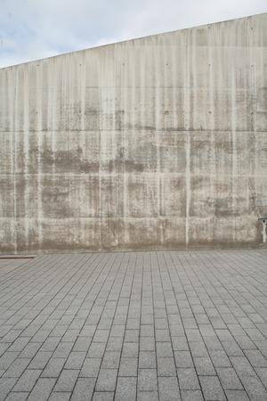 Cobblestones and a concrete wall
