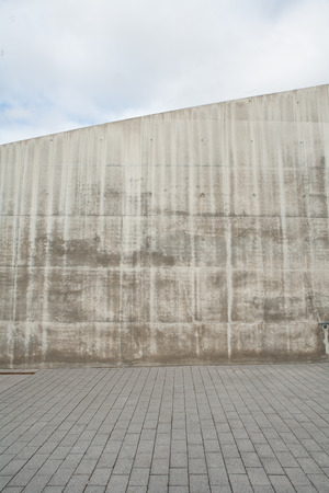 Concrete wall with Cobblestones in front Stock Photo