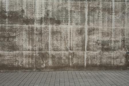 Cobblestones and concrete wall