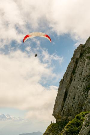 Paraglider on Mount Pilatus above Swiss Alps Stock Photo