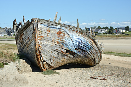 Old shipwreck on beach in France