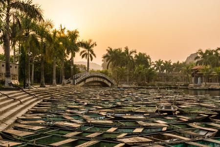 Harbor full of small tourist boats on river in Ninh Binh, Vietnam