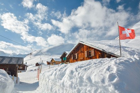 Wooden huts covered by snow in Sedrun ski resort in Switzerland