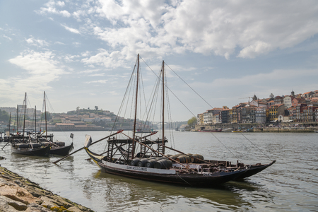Porto, Portugal - April 22, 2018: Wooden ships on Douro river in Vila Nova de Gaia, Portugal which is on the other side of Porto during spring 2018 Redakční