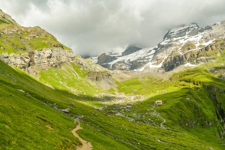 Walking trail in Swiss Alps near Oeschinensee lake Stock Photo