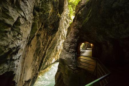 Walking trail through narrow, dark and deep Aare canyon in canton of Bern, Switzerland
