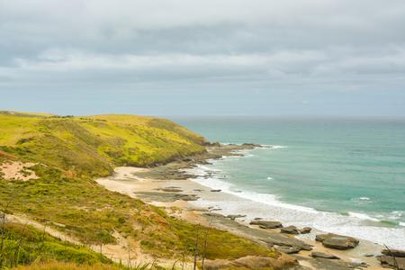 Beautiful Pacific ocean coast near Omapere, New Zealand Stock Photo