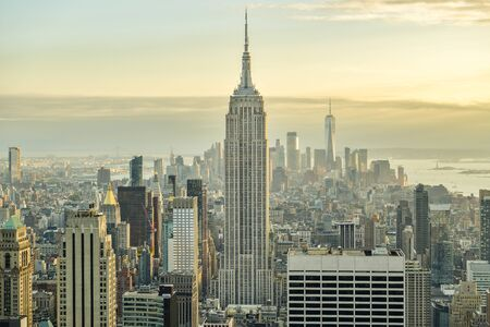 New York City, United States - October 5, 2018: Beautiful view on Manhattan with dominant Empire State Building in front as seen from top of Rockefeller Center in New York, United States shortly before the sunset during October 2018