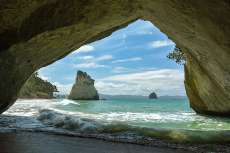 Cathedral Cove, naturally formed archway on beach near Coromandel, New Zealand is probably the most picturesque spot in the country Stock Photo