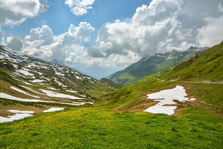 View from Klausenpass, high mountain road in Swiss Alps during late spring