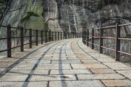 Path on top of Grimselsee dam close to Grimselpass in Swiss Alps Stock Photo