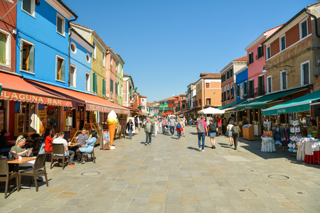Venice, Italy - April 20, 2019: Main street Via Baldassare Galuppi on small island Burano, close to Venice, Italy duding start of touristic season 2019 報道画像