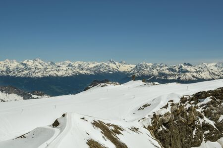 View from top of Scex Rouge on glacier and still snowy Swiss Alps