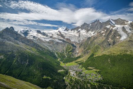 View on Saas-Fee village with beautiful Alps and Fee glacier in background in southern Switzerland Archivio Fotografico