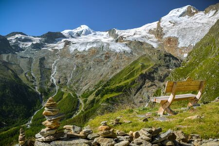 Just to sit and relax looking at majestic Fee Glacier located above Saas-Fee village in Swiss Alps