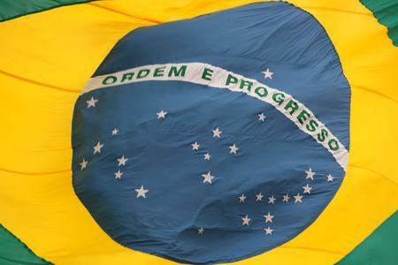 National flag of Brazil fling high on a tall ship Stock Photo