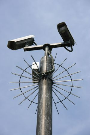Security cameras protected by steel spikes Stock Photo