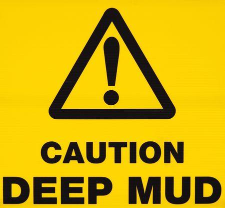 Caution deep mud warning sign