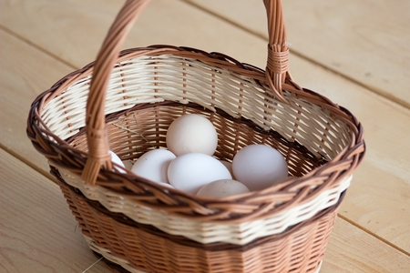 Quality chicken eggs from domestic breeding in a wicker basket