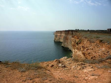 annexation: Crimean coast. Cape Tarkhankut. Black Sea. Rocky inhospitable coast and transparent calm azure sea.