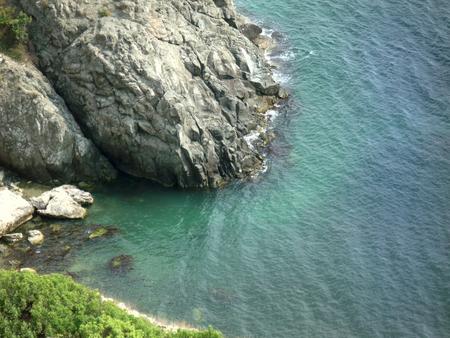 inhospitable: Crimean coast. Cape Tarkhankut. Black Sea. Rocky inhospitable coast and transparent calm azure sea.
